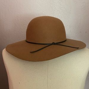 Tan fedora hat with black bow
